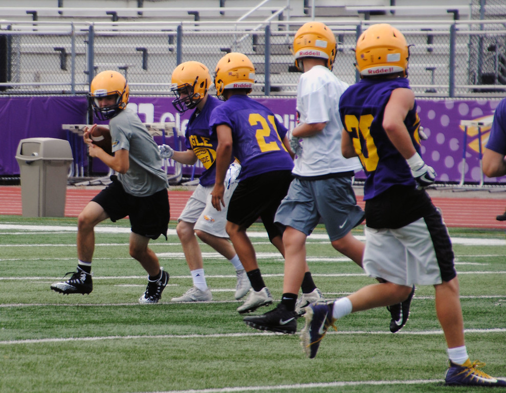 . Jon Behm - The Morning Journal<br> Scenes from Avon\'s first day of football practice on July 30.