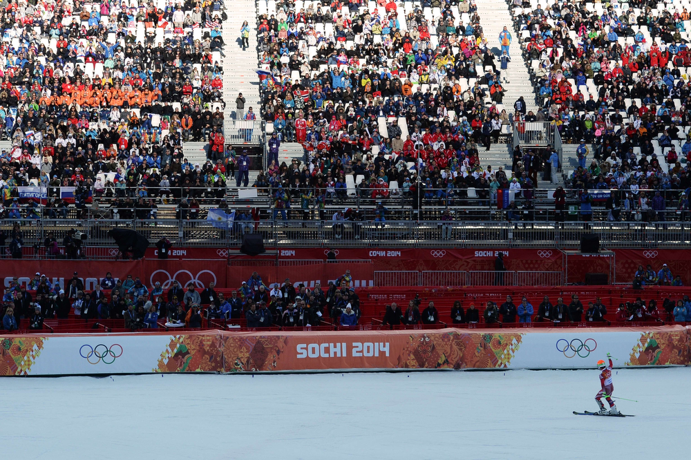 . A picture taken with a robotic camera shows Switzerland\'s gold medalist Sandro Viletta celebrating in the finish area after the Men\'s Alpine Skiing Super Combined at the Rosa Khutor Alpine Center during the Sochi Winter Olympics on February 14, 2014.  (ANTONIN THUILLIER/AFP/Getty Images)