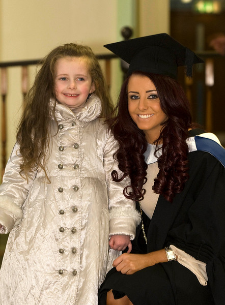 """4/1/2012. News. Waterford Institute of Technology (WIT), conferring ceremony. Niamh Manning who graduated in Bachelor of Business with her niece Faye Hutchinson from Waterford City. Photo Patrick Browne  Upbeat mood at WIT's conferring ceremonies  An optimistic note has been signaled by Mr Tony McFeely, Acting President of Waterford Institute of Technology (WIT), at the first of 11 conferring ceremonies across three days during which 2,652 students were conferred with academic degrees up to doctorate level.  In his conferring address, Mr McFeely said: """"We cannot ignore the dark economic clouds that have surrounded the country for the past few years. Job opportunities are not as readily available as they once were. However, your academic achievements should instill a sense of self-confidence. I would encourage you to remain positive and optimistic despite the general gloom. These times will pass; they always do.""""  """"We Irish are a resilient people; you are the potential leaders of the future so it's incumbent on you to remain strong and positive,"""" continued Mr McFeely. He urged today's graduates to remember the words of Apple founder Steve Jobs at a Stanford graduation in 2005: """"Your time is limited, so don't waste it living someone else's life. Don't be trapped by dogma, which is living with the results of other people's thinking. Don't let the noise of others' opinions drown out your own inner voice. And most important, have the courage to follow your heart and intuition.""""  WIT's Chairman, Dr Donie Ormonde, continued the positive theme in his remarks: """"In the modern economy skills and competencies are the tradable commodities that enhance your life experiences and enhance the creative edge of economic and social development. Ireland's capacity to bounce back is directly related to the education and skills infrastructure that it has built. Ireland is an international leader in educational attainment and it is this that will provide the stepping stone to recovery.""""  T"""