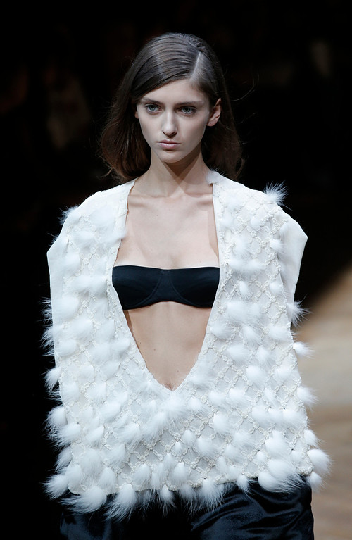 . A model wears a creation for Irish fashion designer Sharon Wauchob\'s ready-to-wear Spring/Summer 2014 fashion collection, presented in Paris, Thursday, Sept.26, 2013. (AP Photo/Christophe Ena)