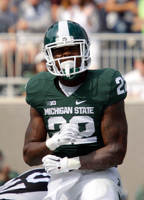 . Michigan State\'s Delton Williams celebrate his touchdown against Eastern Michigan during the second quarter of an NCAA college football game, Saturday, Sept. 20, 2014, in East Lansing, Mich. Michigan State won 73-14. (AP Photo/Al Goldis)