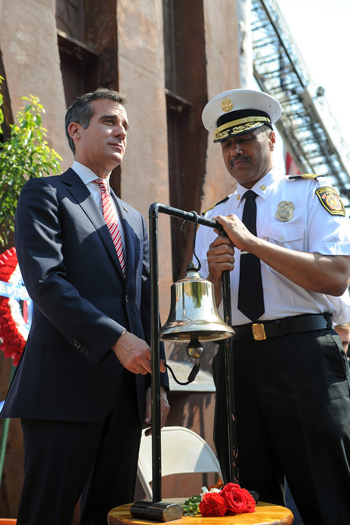 . Mayor Eric Garcetti, left, and LADF Chief Brian L. Cummings enact the bell ringing ceremony at the 9/11 Remembrance Ceremony at the World Trade Center Memorial at LAFD Frank Hotchkin Memorial Training Center, Thursday, September 11, 2013. (Photo by Michael Owen Baker/L.A. Daily News)