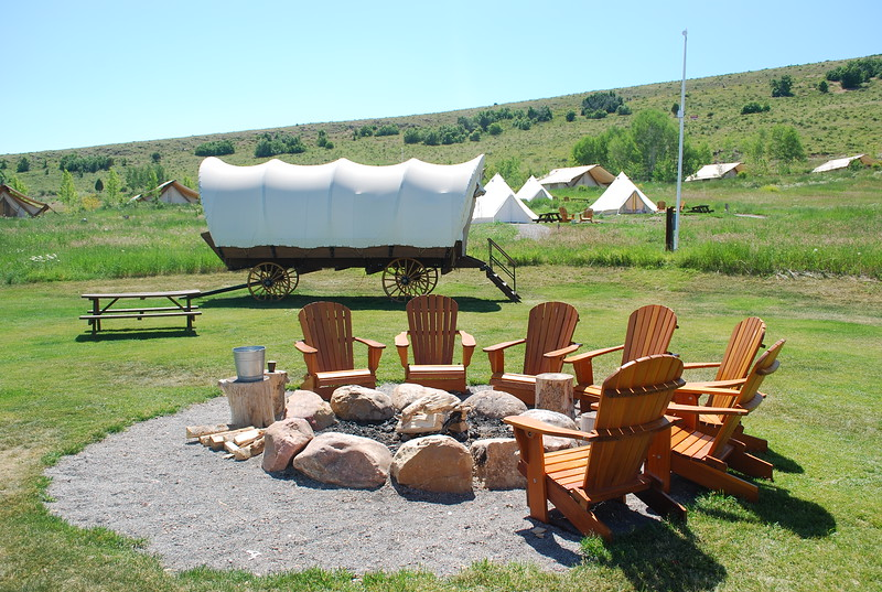 White conestoga wagon with firepit in the foreground