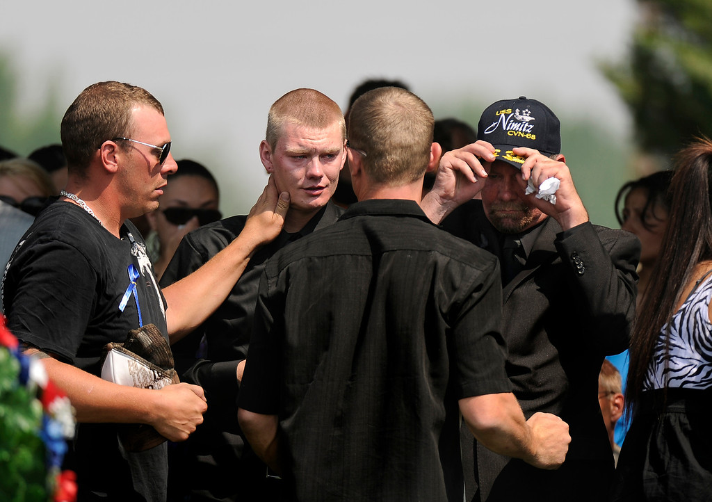 . Dillon Blunk, younger brother of Jonathan Blunk, is consoled by friends and family after the conclusion of prayers at his brother\'s graveside at Mountain View Mortuary in Reno, Nevada, Friday, August 03, 2012.
