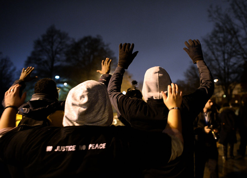 ". Demonstrators have their ""hands up\"" as they march in St. Louis, Missouri, on November 23, 2014 to protest the death of 18-year-old Michael Brown. More than 100 protesters marched peacefully through St Louis on November 23, stepping up pressure on a grand jury to indict a white police officer for shooting dead an unarmed black teenager. Police stepped up security and erected barricades bracing for the worst with a grand jury to decide whether to indict the police officer. Brown was shot at least six times by police officer Darren Wilson in the St. Louis suburb of Ferguson on August 9, inflaming racial tensions and sparking weeks of protests, some violent. JEWEL SAMAD/AFP/Getty Images"