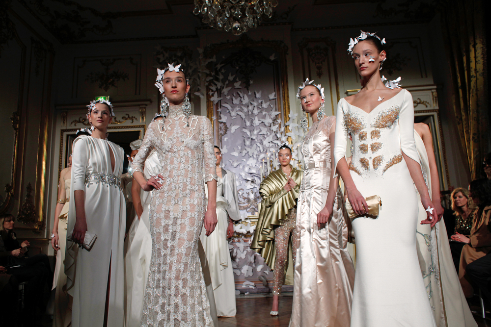. Models present creations as part of the Alexis Mabille Spring-Summer 2014 Haute Couture fashion collection, presented Monday, Jan. 20, 2014 in Paris. (AP Photo/Thibault Camus)
