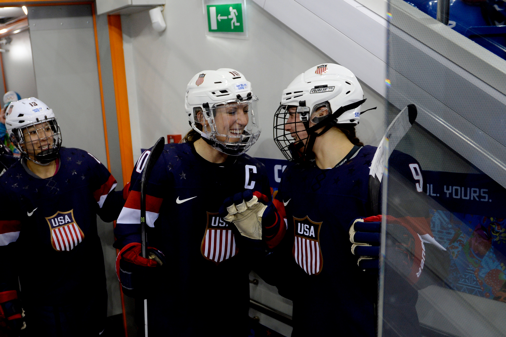 . U.S.A. hockey players Meghan Duggan (10) and Megan Bozek (9) joke before the third period of the United States\' 3-1 win against Finland. Sochi 2014 Winter Olympics on Saturday, February 8, 2014. (Photo by AAron Ontiveroz/The Denver Post)