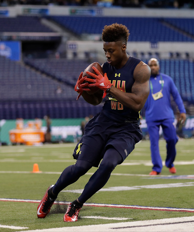 . Ohio State wide receiver Curtis Samuel runs a drill at the NFL football scouting combine Saturday, March 4, 2017, in Indianapolis. (AP Photo/David J. Phillip)