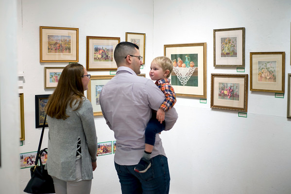 12/06/19 Wesley Bunnell | StaffrrThe Art League of New Britain is holing an exhibit titled Art in the Family A Retrospective by Kenneth Larson (1947-1994) Liz Winchester-Larson and their daughter Sarah Larson. Jessica Larson and Anthony Gagliardi walk through the exhibit while holding Thomas Laron, age 2 on the opening night on December 6, 2019.