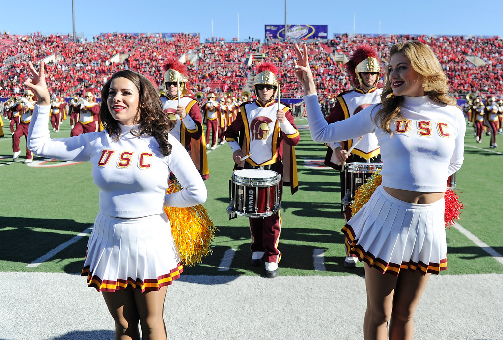 . LAS VEGAS, NV - DECEMBER 21:  USC Trojans Song Girls Alexa Trujillo (L) and Perry Mattfeld perform with the USC marching band before the team\'s game against the Fresno State Bulldogs in the Royal Purple Las Vegas Bowl at Sam Boyd Stadium on December 21, 2013 in Las Vegas, Nevada. USC won 45-20.  (Photo by Ethan Miller/Getty Images)