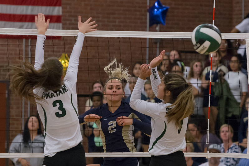 Platt's Vanessa Isyk sends a spike down the line for a kill Monday at Maloney High School in Meriden October 2, 2017 | Justin Weekes / For the Record-Journal