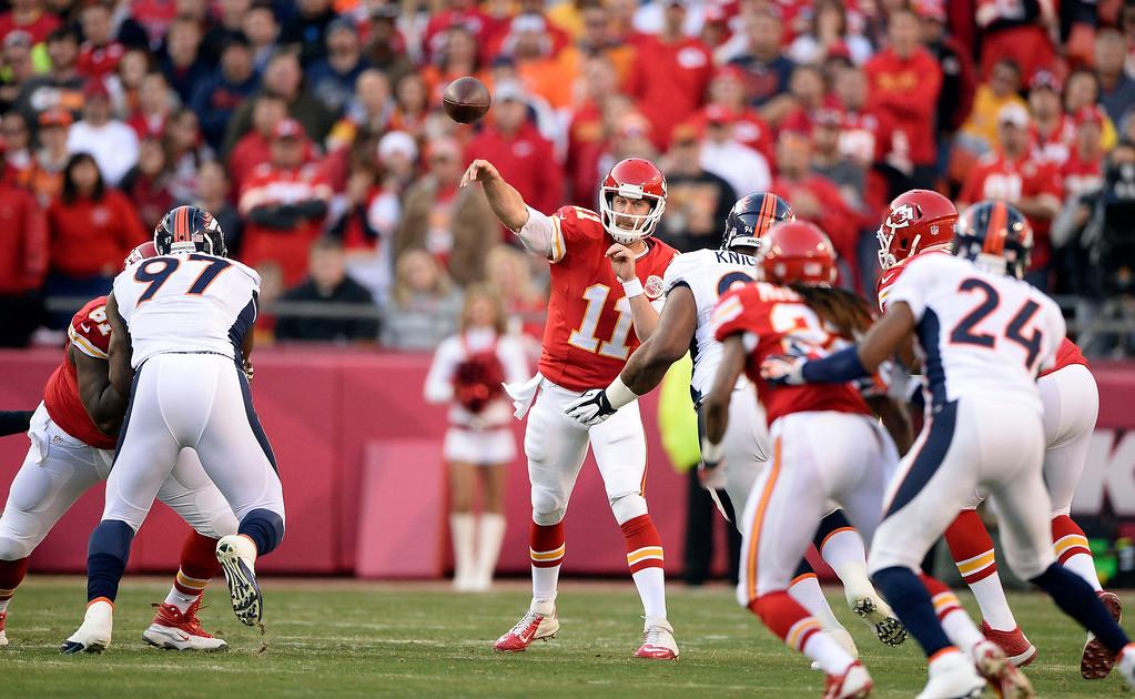 . Kansas City Chiefs quarterback Alex Smith (11) throws a pass against the Denver Broncos defense during the first quarter December 1, 2013 at Arrowhead Stadium.  (Photo by John Leyba/The Denver Post)