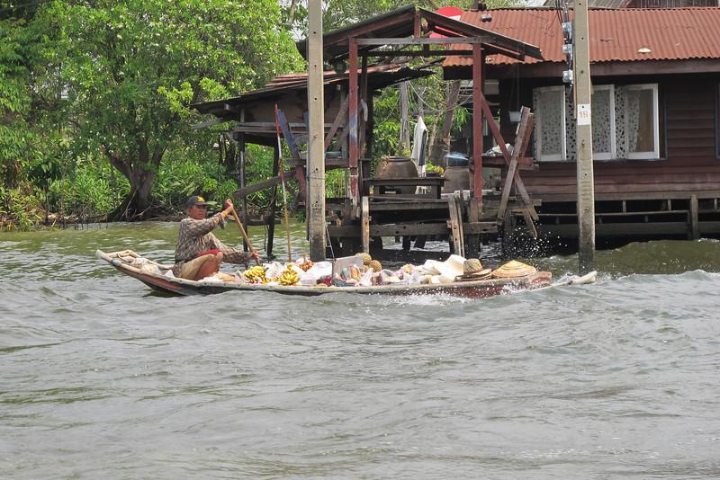 Vendor bringing fresh fruit and sundries to residents along the Khlong Bangkok Noi (the former Chao Phraya River).