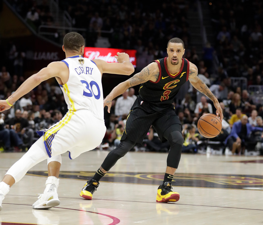 . Cleveland Cavaliers\' George Hill is defended by Golden State Warriors\' Stephen Curry in the second half of Game 4 of basketball\'s NBA Finals, Friday, June 8, 2018, in Cleveland. (AP Photo/Tony Dejak)