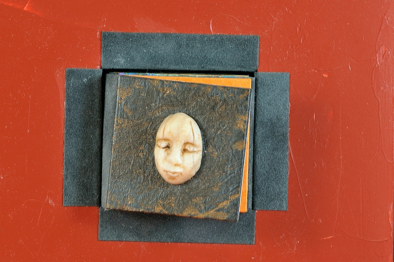 7 June 2010: A close up of a handmade book, by Fruma Shrensel. It's about door knockers and door knobs in Italy.