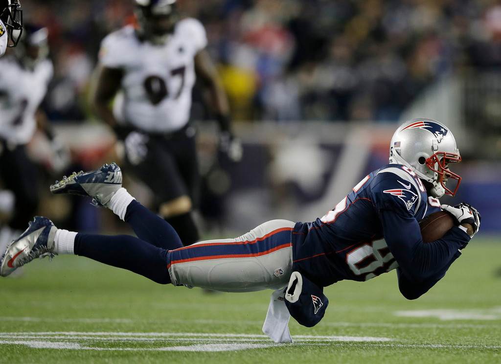 . New England Patriots wide receiver Brandon Lloyd makes a catch during the first half of the NFL football AFC Championship football game against the Baltimore Ravens in Foxborough, Mass., Sunday, Jan. 20, 2013. (AP Photo/Matt Slocum)