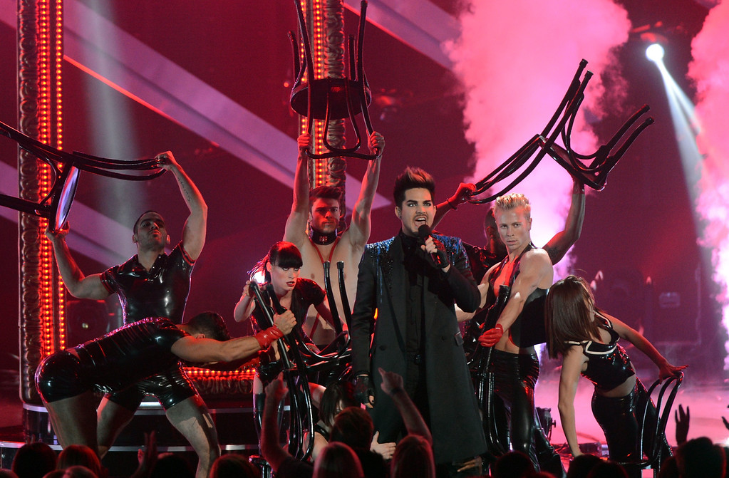 ". LOS ANGELES, CA - DECEMBER 16:  Host Adam Lambert performs onstage during ""VH1 Divas\"" 2012 at The Shrine Auditorium on December 16, 2012 in Los Angeles, California.  (Photo by Kevin Winter/Getty Images)"