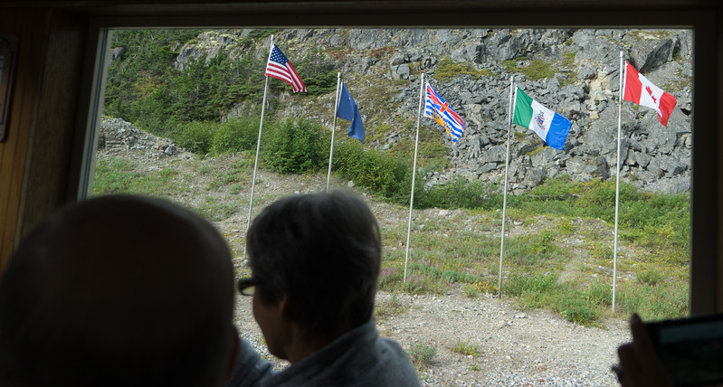 At the border, flags of the U.S. Alaska, British Columbia, Yukon Territory, and Canada