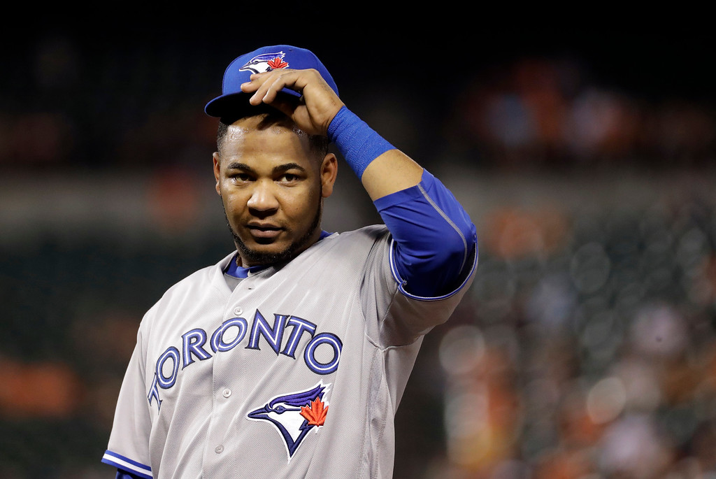 . Toronto Blue Jays first baseman Edwin Encarnacion adjusts his cap during a baseball game against the Baltimore Orioles in Baltimore, Wednesday, Aug. 31, 2016. (AP Photo/Patrick Semansky)