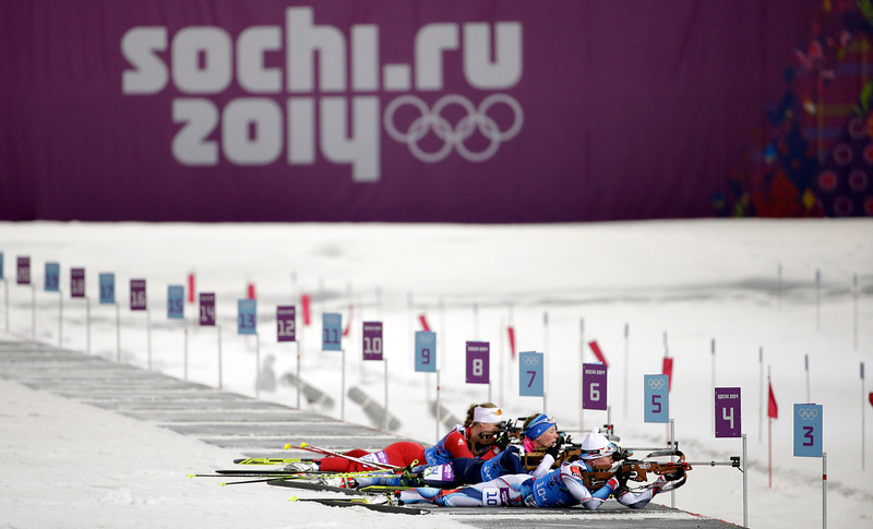. Competitors shoot during the women\'s biathlon 4x6k relay at the 2014 Winter Olympics, Friday, Feb. 21, 2014, in Krasnaya Polyana, Russia. (AP Photo/Felipe Dana)