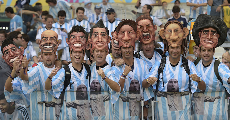 . Argentinian fans cheer prior to a Group F football match between Argentina and Iran at the Mineirao Stadium in Belo Horizonte during the 2014 FIFA World Cup in Brazil on June 21, 2014.  (JUAN MABROMATA/AFP/Getty Images)