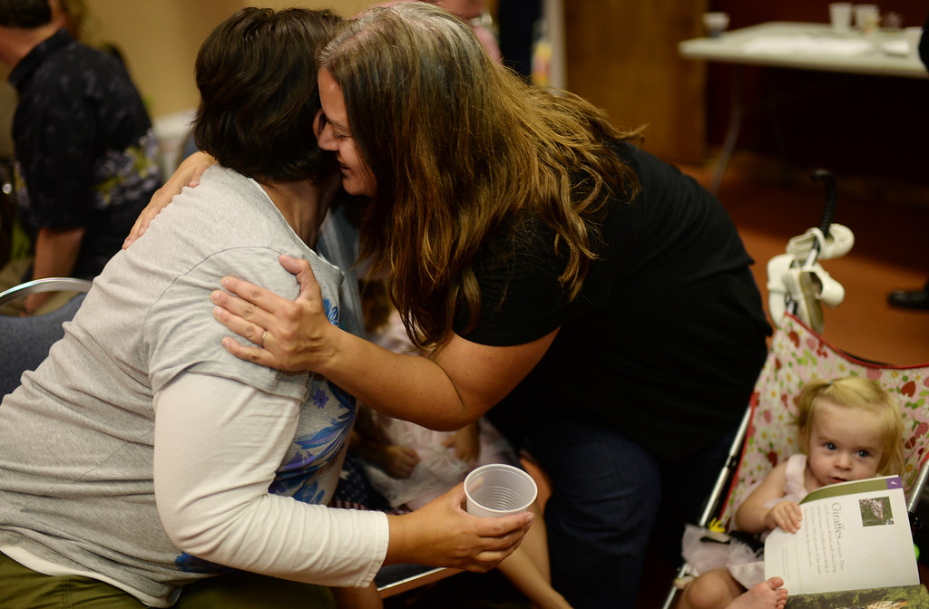 . COLORADO SPRINGS, CO - September 10 : Bernie Herpin\'s daughters Nikki Lindquist, left, and Tiffany Koch are celebrating their father\'s winning at Colorado El Paso County Republican Party Headquarters. Colorado Springs, Colorado. September 10, 2013. (Photo by Hyoung Chang/The Denver Post)