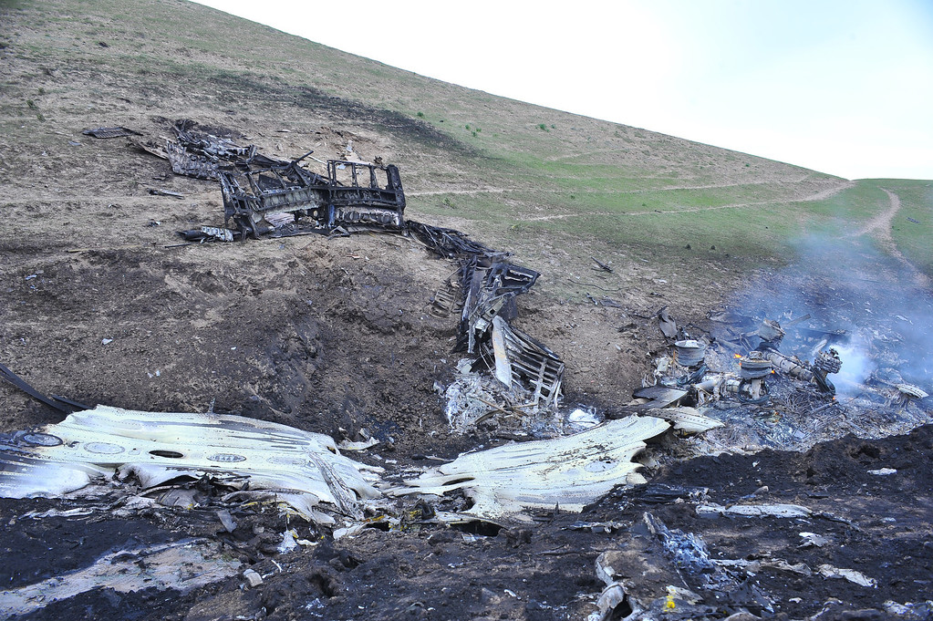 . The remains of a crashed US KC-135 Stratotanker plane are seen on a hill near the villages of Chorgolo and Cholok-Aryk, Kyrgyzstan, on May 3, 2013. The refuelling plane from the U.S. Manas airbase in Kyrgyzstan crashed after taking off, the emergency situations ministry told AFP on Friday. Among the dead are Air Force Capt. Victoria Pinckney of Palmdale, a mother of a baby. (SABYR AILCHIYEV/AFP/Getty Images)