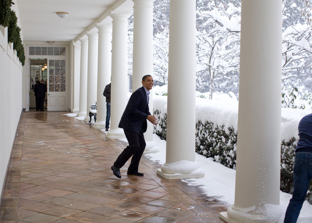 "Description of . Dec. 19, 2009 ""Snowball in hand, the President chases Chief of Staff Rahm Emanuel on the White House colonnade. To escape, Rahm ran through the Rose Garden, which unfortunately for him, was knee-deep in snow."" (Official White House photo by Pete Souza)"