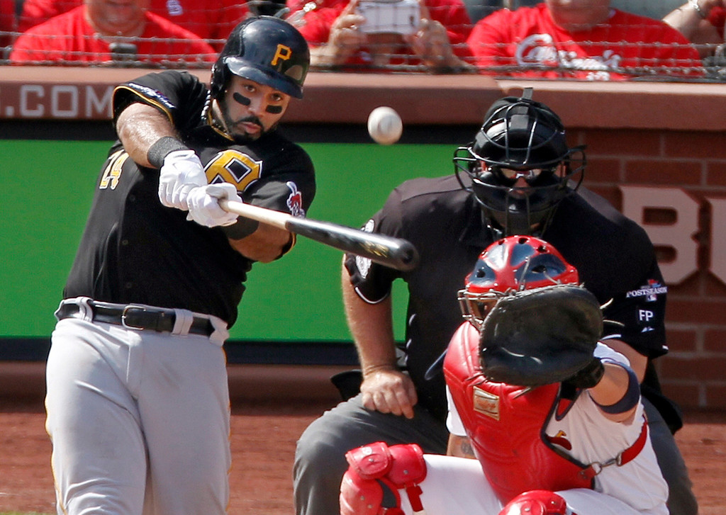 . Pittsburgh Pirates\' Pedro Alvarez (24) hits a two-run home run against the St. Louis Cardinals in the third inning of Game 2 of baseball\'s National League division series on Friday, Oct. 4, 2013, in St. Louis. Catching for the Cardinals is Yadier Molina. (AP Photo/Sarah Conard)
