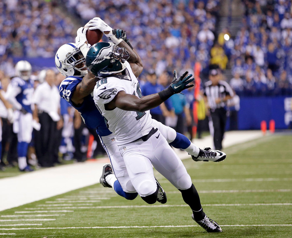 . Indianapolis Colts Greg Toler makes an interception against Philadelphia Eagles wide receiver Jeremy Maclin (18) during the first half of an NFL football game Monday, Sept. 15, 2014, in Indianapolis. (AP Photo/AJ Mast)