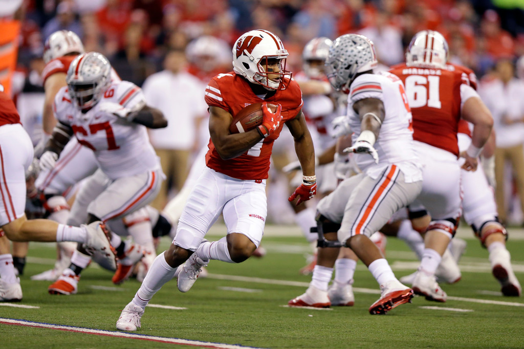 . Wisconsin wide receiver A.J. Taylor runs with the ball during the first half of the Big Ten championship NCAA college football game, Saturday against Ohio State, Dec. 2, 2017, in Indianapolis. (AP Photo/Michael Conroy)