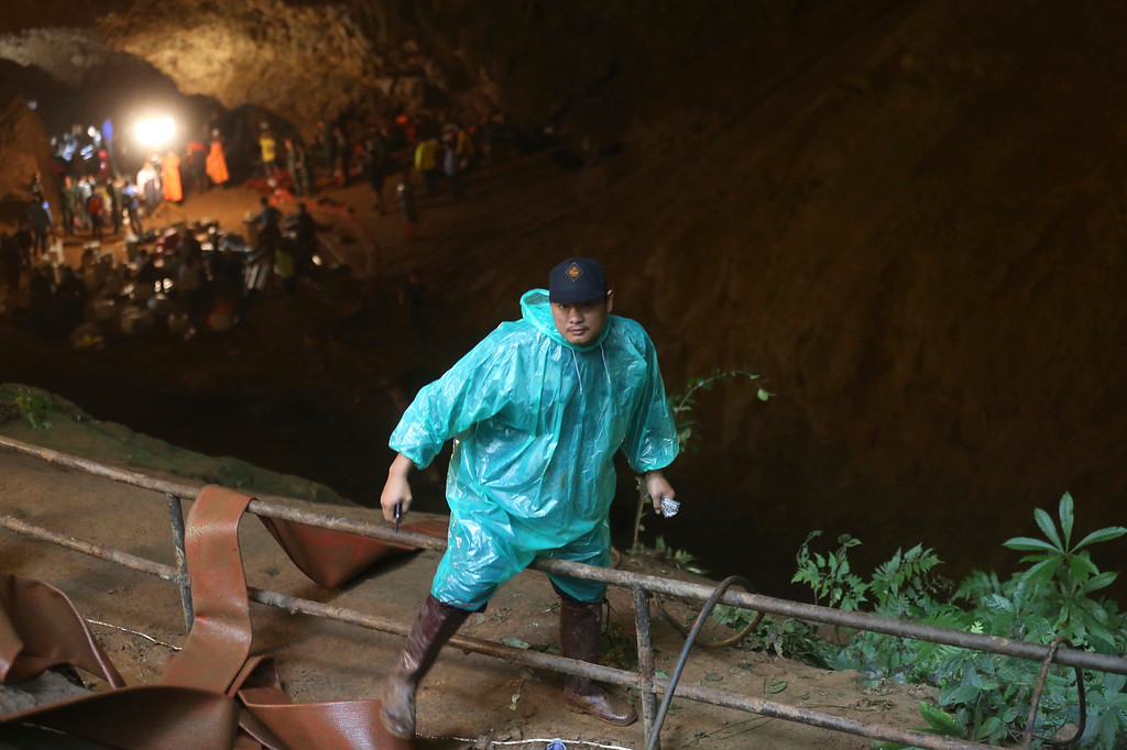 . A rescue worker climbs out of the staging area at the entrance of a cave complex where it\'s believed that 12 soccer team members and their coach went missing, Wednesday, June 27, 2018, in Mae Sai, Chiang Rai province, northern Thailand. Rain is continuing to fall and water levels keep rising inside a cave in northern Thailand, frustrating the search for the boys and their soccer coach who have been missing since Saturday. (AP Photo/Sakchai Lalit)