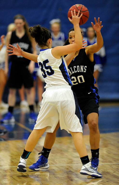 . PARKER, CO. - FEBRUARY 15: Falcons guard Ciera Morgan guarded Titans senior Shelby Stovall (35) in the second half. The Highlands Ranch High School girls\'s basketball team defeated Legend 76-31 Friday night, February 15, 2013. Falcon\'s coach Caryn Jarocki earned her 500th career win. (Photo By Karl Gehring/The Denver Post)