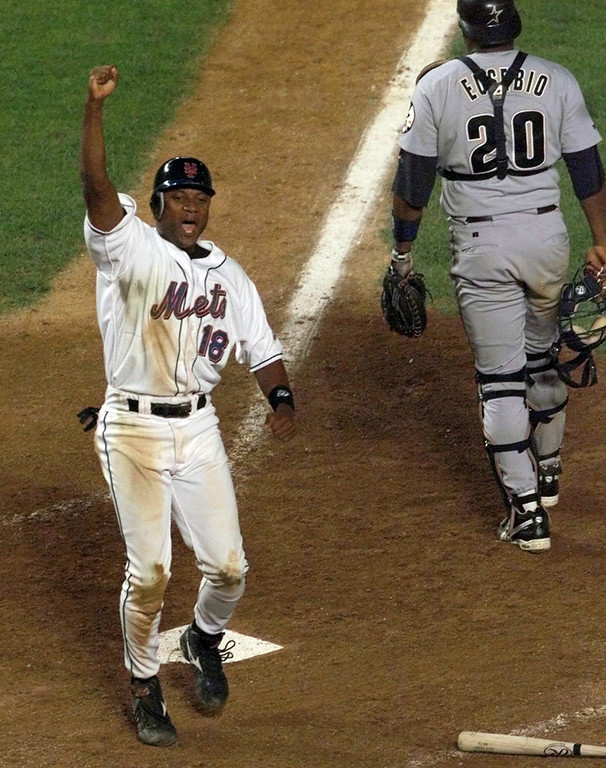 . In this Aug. 23, 1999, file photo, New York Mets\' Darryl Hamilton celebrates as he scores the game-winning run on a Matt Franco hit to left field in the bottom of the ninth inning that gave the Mets a 3-2 victory over the Houston Astros in a baseball game at Shea Stadium in New York. Authorities say Hamilton was killed Sunday, June 21, 2015, in a murder-suicide in the Houston suburb of Pearland, Texas. Pearland police say an initial investigation has determined Hamilton had been shot several times and that a woman in the home died of a self-inflicted gunshot wound. The woman was identified as Monica Jordan. (AP Photo/Ron Frehm, File)