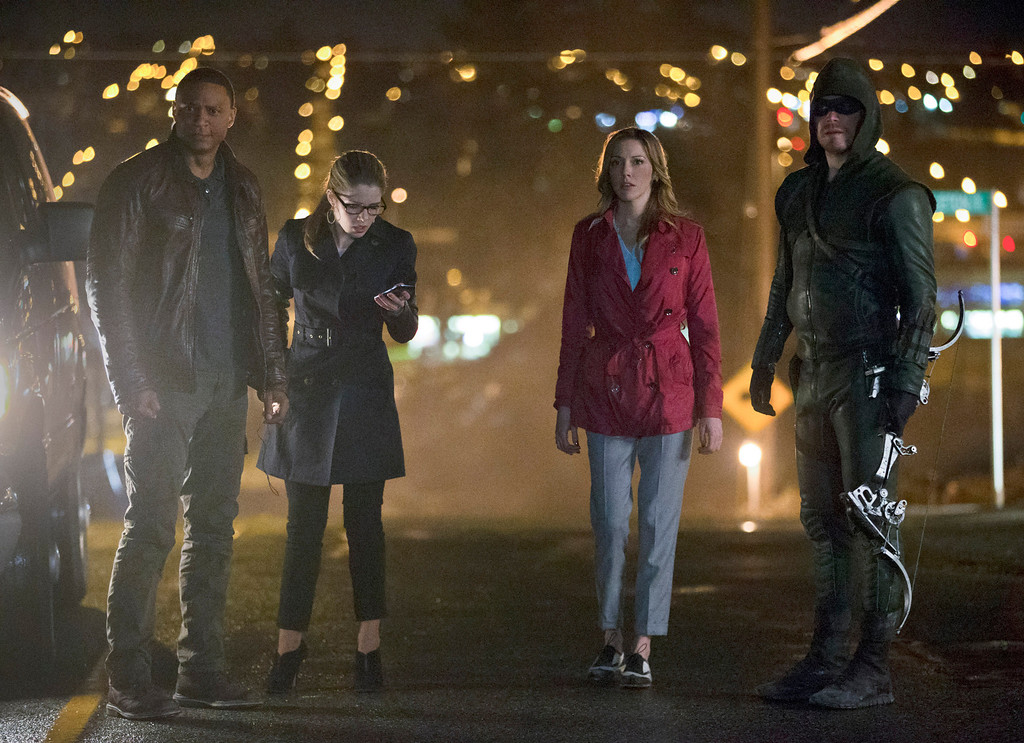 """. David Ramsey as John Diggle, Emily Bett Rickards as Felicity Smoak, Katie Cassidy as Laurel Lance, and Stephen Amell as The Arrow in The CW\'s \""""Arrow.\""""  (Photo by Jack Rowand/The CW -- © 2014 The CW Network, LLC. All Rights Reserved.)"""