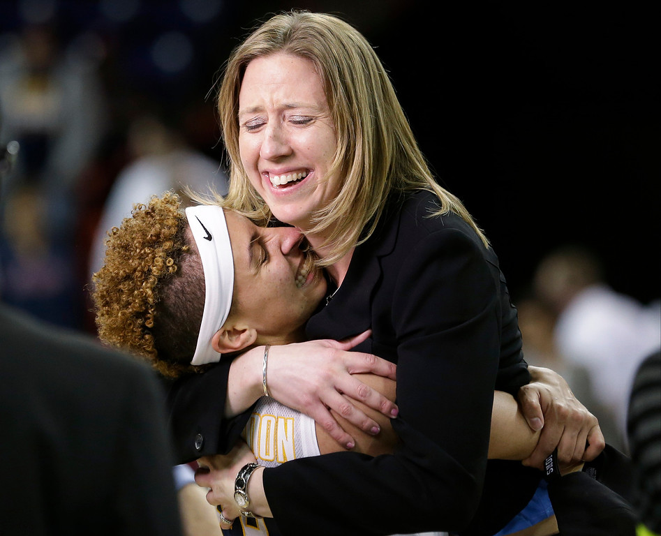 . California head coach Lindsay Gottlieb, right, is embraced by Layshia Clarendon after the team beat Georgia in overtime in a regional final in the NCAA women\'s college basketball tournament, Monday, April 1, 2013, in Spokane, Wash. Cal won 65-62. (AP Photo/Elaine Thompson)