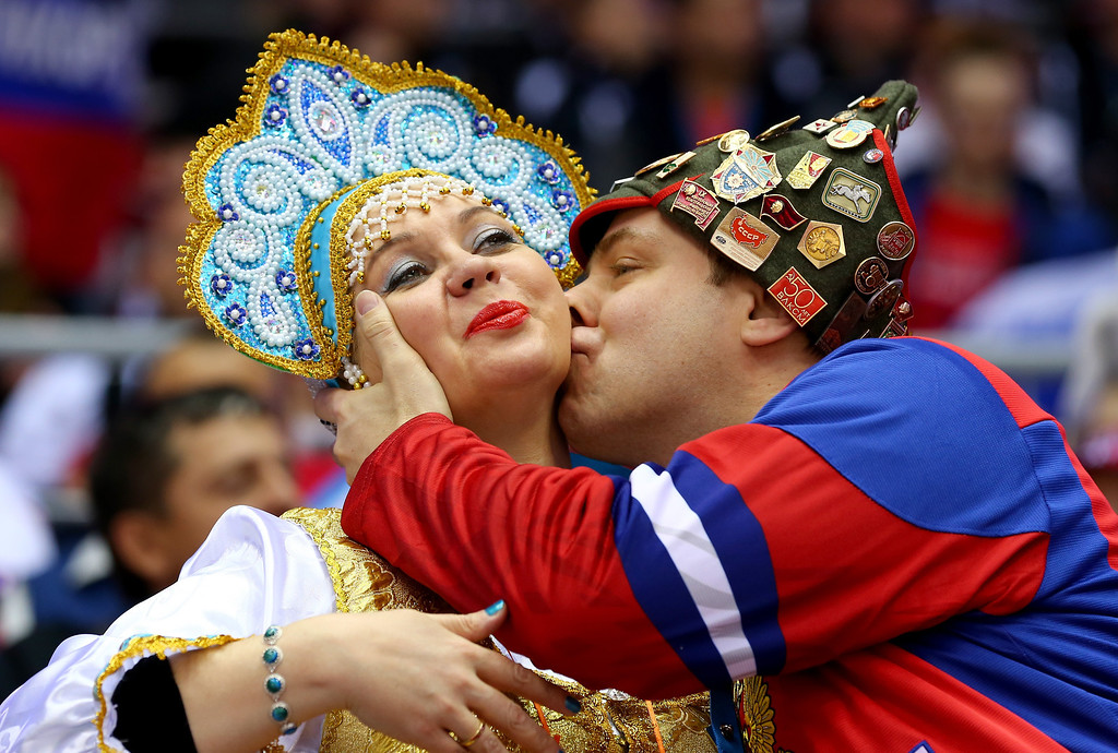. SOCHI, RUSSIA - FEBRUARY 19:  Russian fans kiss during the Men\'s Ice Hockey Quarterfinal Playoff between Finland and Russia on Day 12 of the 2014 Sochi Winter Olympics at Bolshoy Ice Dome on February 19, 2014 in Sochi, Russia.  (Photo by Martin Rose/Getty Images)