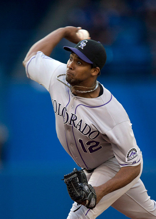 . Colorado Rockies pitcher Juan Nicasio throws against the Toronto Blue Jays during the first inning of a baseball game in Toronto on Wednesday, June 19, 2013. (AP Photo/The Canadian Press, Frank Gunn)