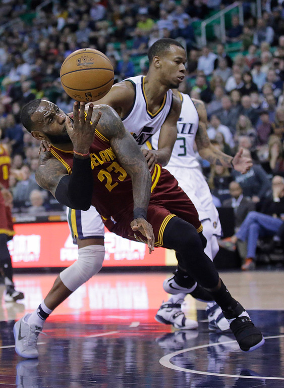 . Utah Jazz guard Rodney Hood, rear, fouls Cleveland Cavaliers forward LeBron James (23) as he lays the ball up in the first half during an NBA basketball game Tuesday, Jan. 10, 2017, in Salt Lake City. (AP Photo/Rick Bowmer)