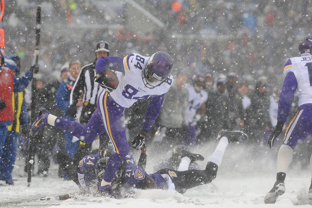 . Wide receiver Cordarrelle Patterson #84 of the Minnesota Vikings runs the ball against the Baltimore Ravens at M&T Bank Stadium on December 8, 2013 in Baltimore, Maryland. (Photo by Larry French/Getty Images)