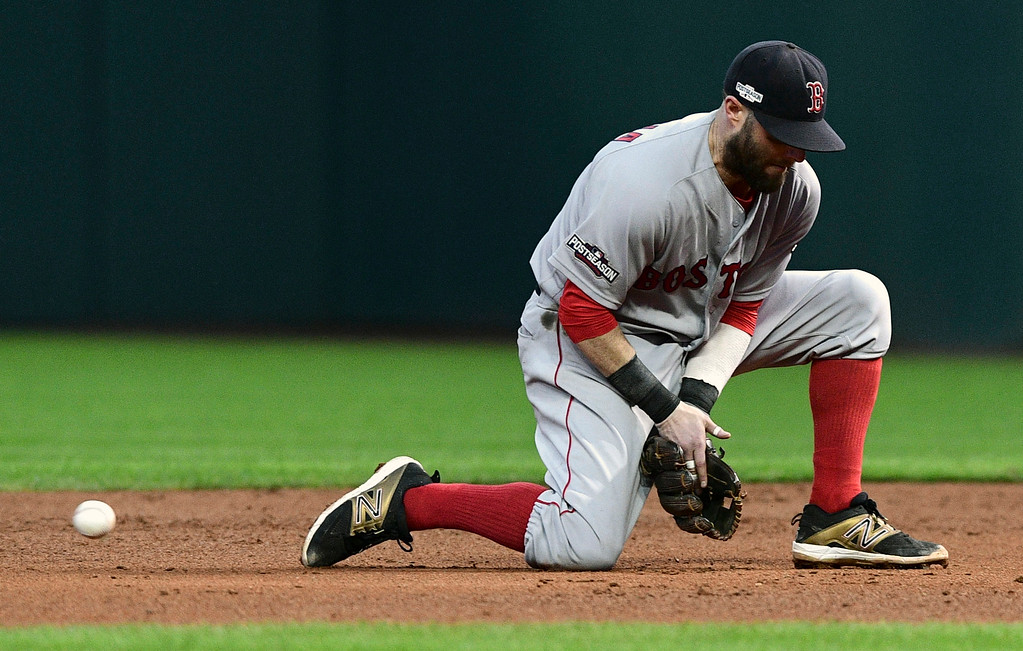 . Boston Red Sox second baseman Dustin Pedroia allows a Cleveland Indians\' Roberto Perez ground ball past him in the sixth inning during Game 2 of baseball\'s American League Division Series, Friday, Oct. 7, 2016, in Cleveland. Pedroia was charged with an error. 1e(AP Photo/David Dermer)
