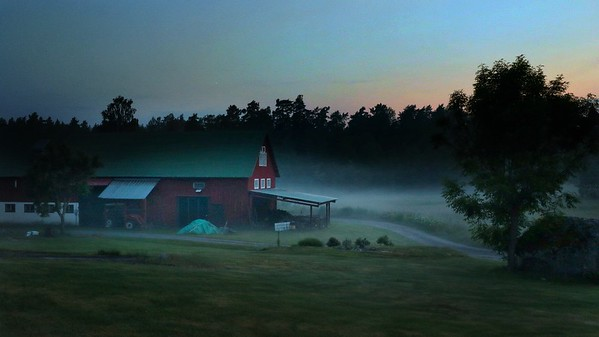 Barn in misty sunset