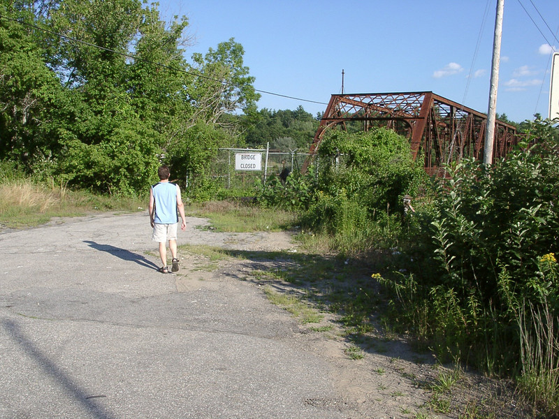 Peter is not daunted by signs or fences. This is the north end of the bridge.