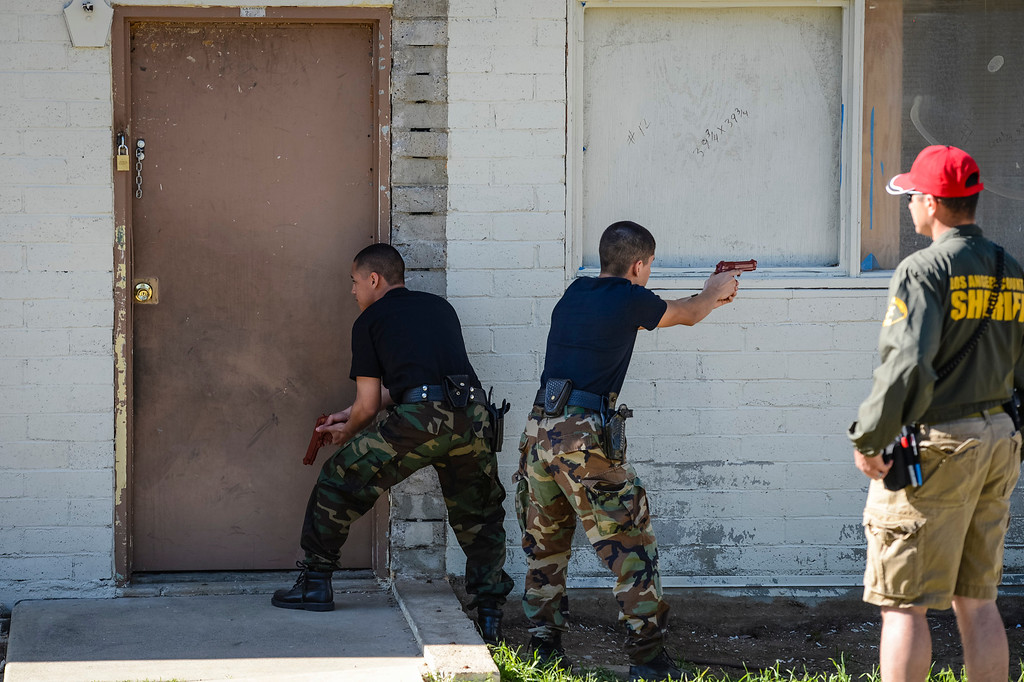 """. Prepare to enter a house with possible armed suspects in a drill at Pitches Detention Center Sunday.  Law enforcement explorer posts participated in a weekend-long competition to sharpen their skills.  During team events such as \""""prowler\"""", \""""felony stop\"""", \""""active shooter\"""" and \""""mud Race\"""", explorers were graded on their skills in each of the tests.  Photo by David Crane/Staff Photographer"""
