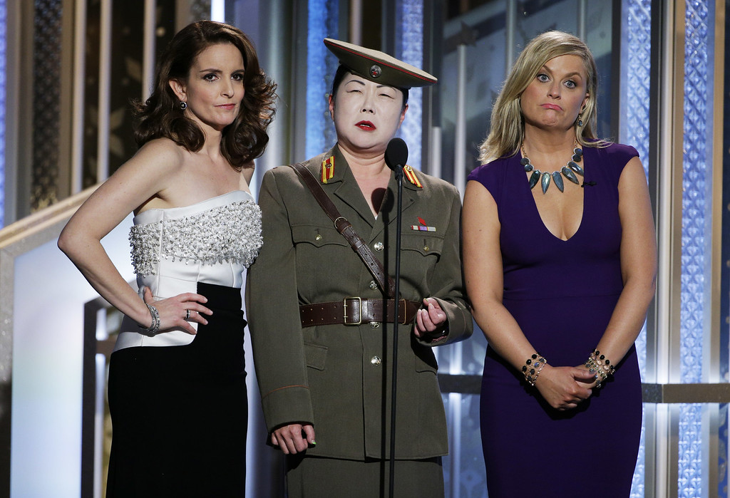 . BEVERLY HILLS, CA - JANUARY 11:  In this handout photo provided by NBCUniversal, Tina Fey,  Margaret Cho and  Amy Poehler speak onstage during the 72nd Annual Golden Globe Awards at The Beverly Hilton Hotel on January 11, 2015 in Beverly Hills, California.  (Photo by Paul Drinkwater/NBCUniversal via Getty Images)