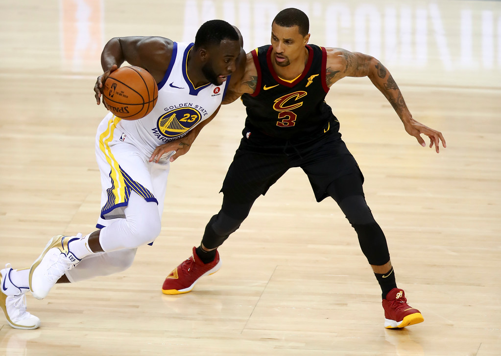 . Golden State Warriors forward Draymond Green (23) drives against Cleveland Cavaliers guard George Hill (3) during the second half of Game 1 of basketball\'s NBA Finals in Oakland, Calif., Thursday, May 31, 2018. (AP Photo/Ben Margot)