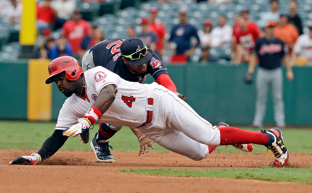 . Cleveland Indians shortstop Francisco Lindor, top, tags out Los Angeles Angels\' Brandon Phillips during the first inning of a baseball game in Anaheim, Calif., Thursday, Sept. 21, 2017. (AP Photo/Chris Carlson)