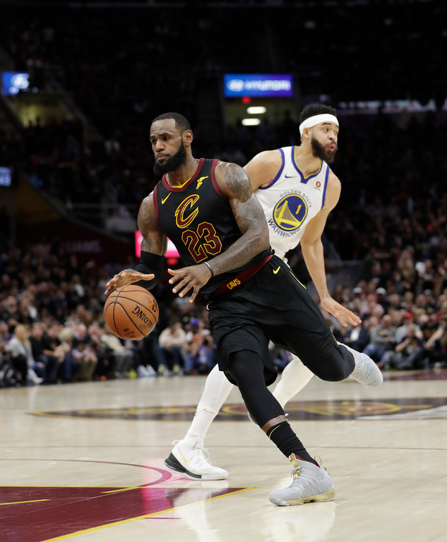 . Cleveland Cavaliers\' LeBron James goes to the basket against Golden State Warriors\' JaVale McGee in the second half of Game 3 of basketball\'s NBA Finals, Wednesday, June 6, 2018, in Cleveland. (AP Photo/Tony Dejak)