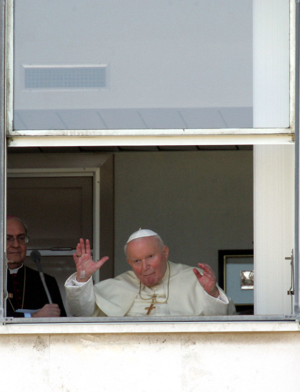 ". Pope John Paul II waves to faithful from a window of Rome\'s Agostino Gemelli hospital where he appeared  Sunday, Feb. 6, 2005. Pope John Paul II was rushed to the hospital Thursday, Feb. 24, 2005, after suffering a relapse of the flu, the Vatican announced, a day after the pontiff made his longest public appearance since being discharged from the clinic two weeks ago. The 84-year-old pontiff was taken to Gemelli Polyclinic hospital after the return of flu symptoms Wednesday afternoon. He was hospitalized for ""necessary specialized assistance and further tests,\"" papal spokesman Joaquin Navarro-Valls said. (AP Photo/Lionel Cironneau)"