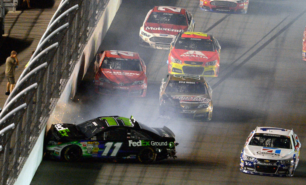 . Denny Hamlin (11) hits the wall, starting a multi-car crash, during the NASCAR Sprint Cup auto race at Daytona International Speedway in Daytona Beach, Fla., Saturday, July 6, 2013. (AP Photo/Phelan M. Ebenhack)